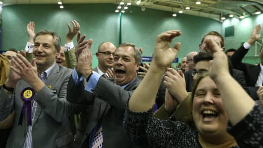 UKIP leader Nigel Farage and supporters celebrate the Mark Reckless' win